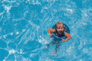 little-girl-in-floaty-swimming.jpg